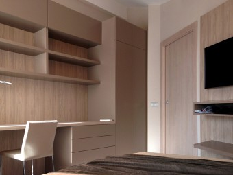 COMPLESSO D'ARREDO realizzato in nobilitato in combinazione di due colori, attrezzata con ripiani, due vani con ante a ribalta, piano-scrivania, cassettiera e armadio.