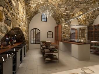 PRIMA SALA. Originali muri storici in sasso parzialmente intonacati ed imbiancati. Pavimento in gres porcellanato. Allestimento costituito da scaffali, librerie, vetrine, ripiani e contenitori per i vini.